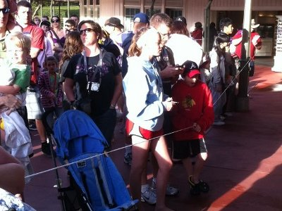 People waiting behind Magic Kingdom rope